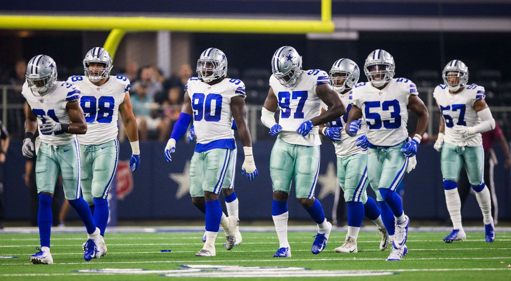 Dallas Cowboys players walk to the sideline after a turnover during the first quarter of an NFL preseason game between the Dallas Cowboys and the Arizona Cardinals on Sunday, August 26, 2018 at AT&T Stadium in Arlington, Texas. (Ashley Landis/The Dallas Morning News)