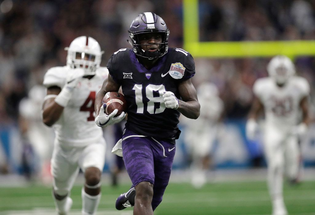 TCU wide receiver Jalen Reagor (18) scores on a 93-yard touchdown reception against Stanford during the second half of the Alamo Bowl NCAA college football game Thursday, Dec. 28, 2017, in San Antonio. (AP Photo/Eric Gay)