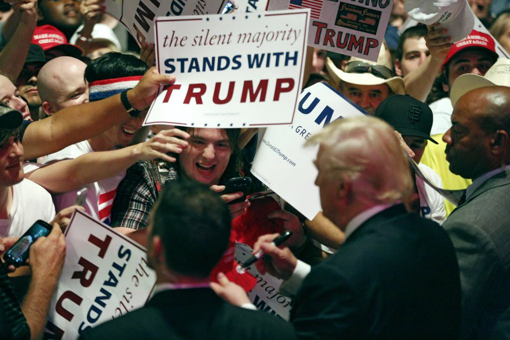 Fans crowded around Donald Trump as he signed autographs during a campaign rally at Gilley's Dallas on June 16, 2016.
