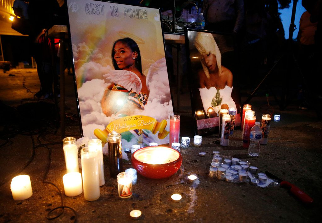 Candles illuminate images of Muhlaysia Booker during a  vigil for her in Dallas on May 22, 2019. Booker, a transgender woman, was the victim of assault at an apartment complex in east Oak Cliff in April and was found dead in Far East Dallas about a month later.