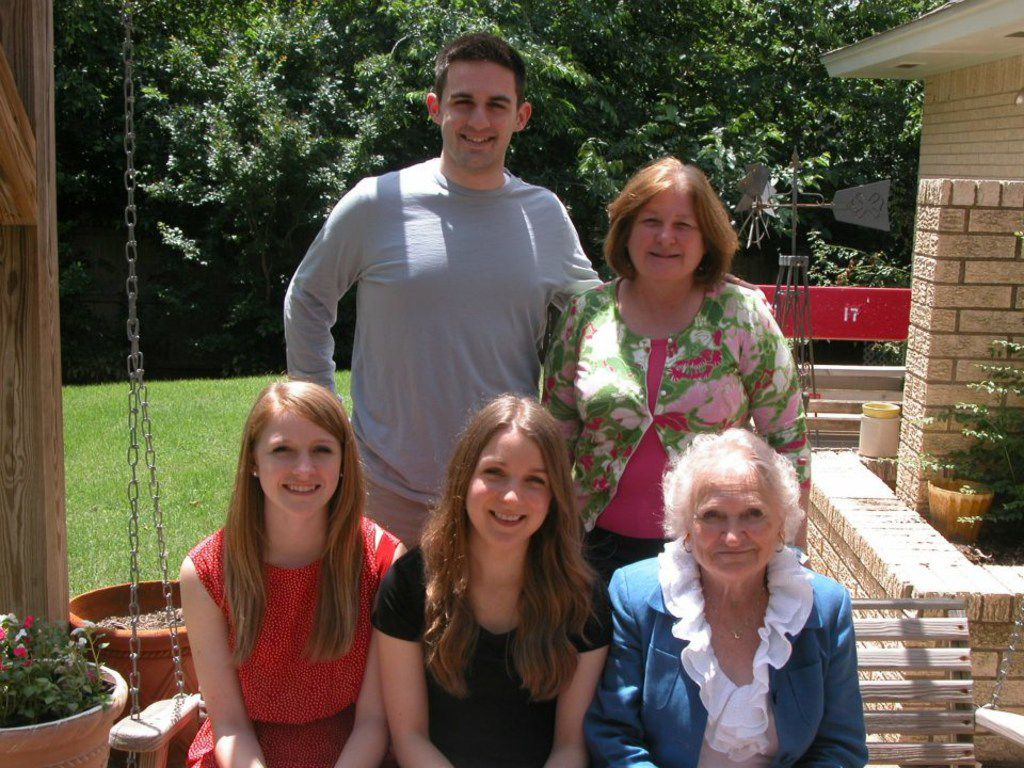 Nancy McCall (right), Nanette Light's grandmother, sits on a porch swing with Light (center) and her younger sister Rebecca Light (left) at McCall's home in Norman, Okla., in 2012. Behind them stands Nanette Light's husband, Rick Loeffler, (left) and her mom, Cindy Light. (Provided by Nanette Light)
