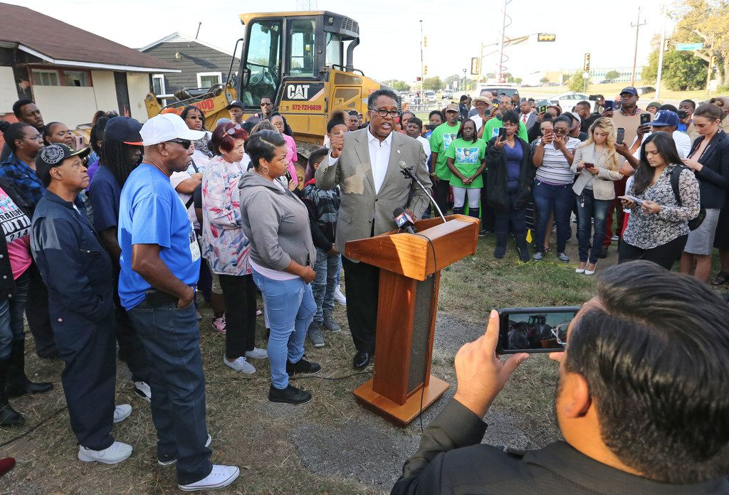 Mayor Pro Tem Dwaine Caraway talks with the crowd before the demolition of the structure at 2208 E. Kiest Boulevard in Oak Cliff south of Dallas, where the body of 13-year-old Shavon Randle was found in July. Photographed on Thursday, October 19, 2017. Randle was kidnapped and held for ransom in a scheme involving drugs, robbery and money in July 2017. (Louis DeLuca/The Dallas Morning News)