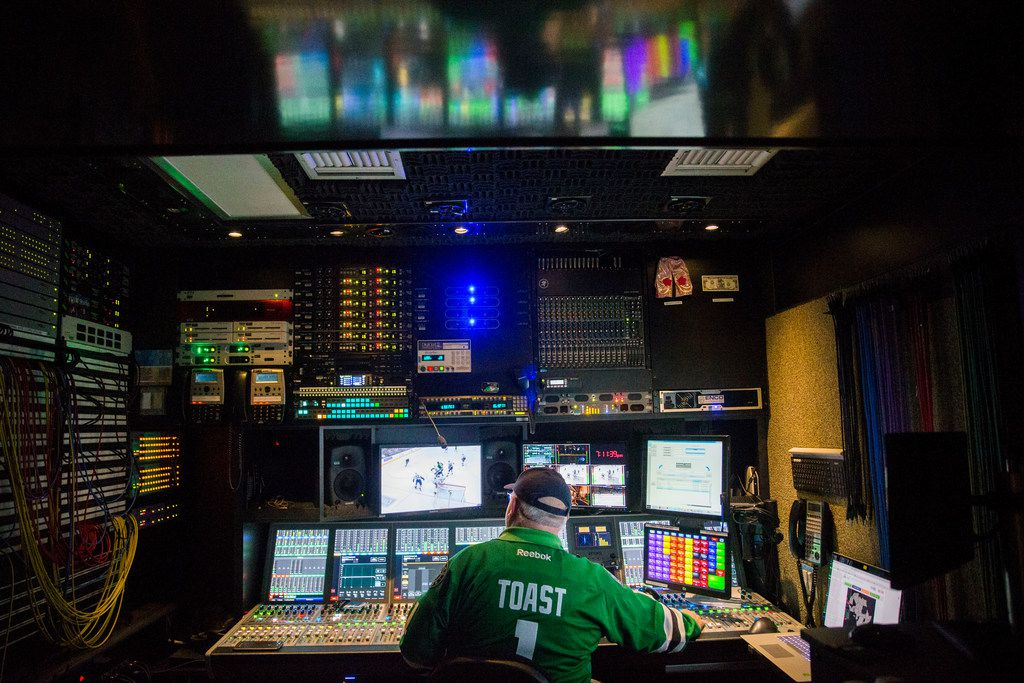 "Senior audio specialist Tim ""Toast"" Record operates an audio mixer during Fox Sports Southwest's television coverage of a hockey game between the Dallas Stars and the Vancouver Canucks at the American Airlines Center in Dallas on Sunday, March 17, 2019.  (Daniel Carde/The Dallas Morning News)"