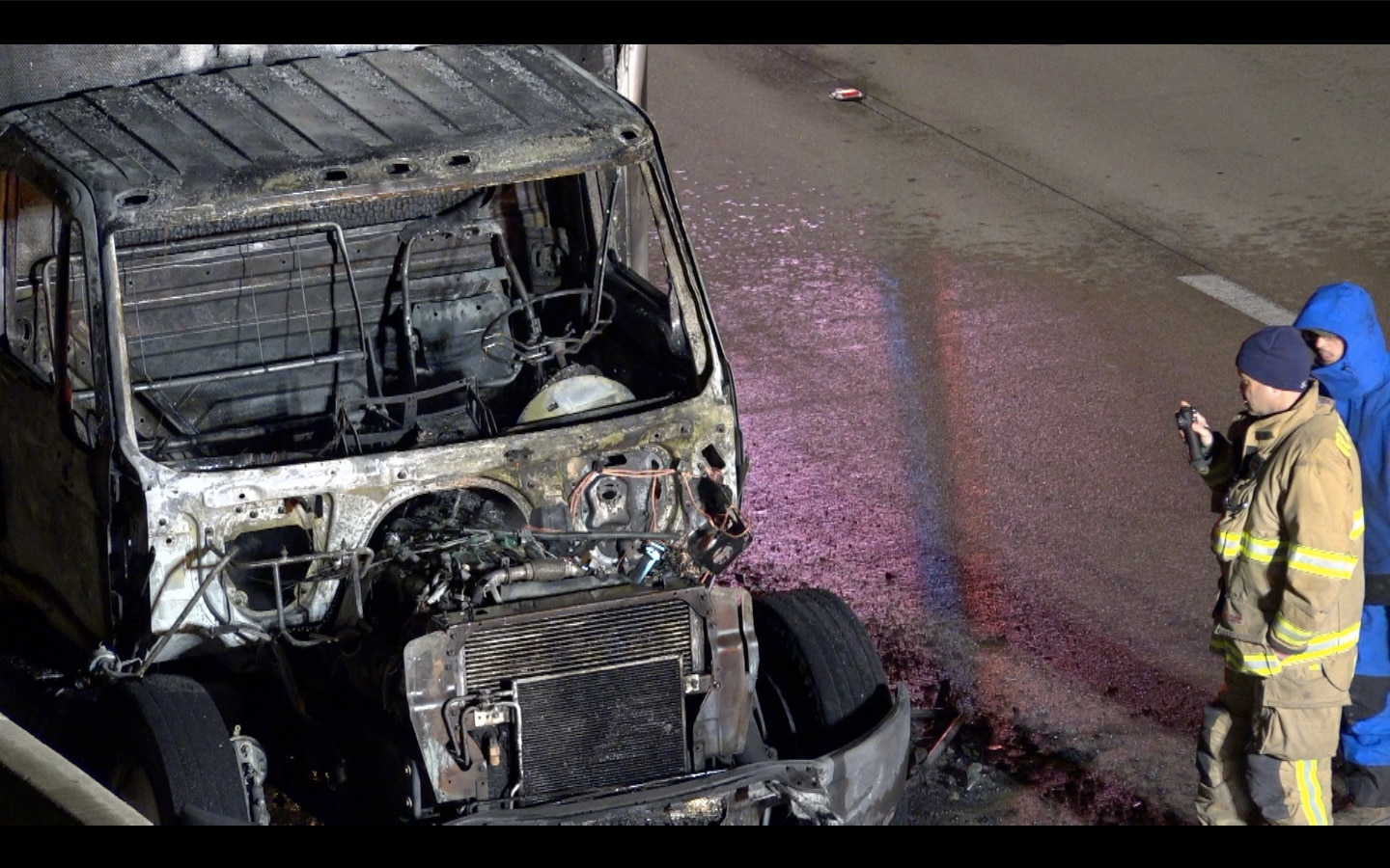 A burned-out truck sits along State Highway 121 in Grapevine after it caught fire Friday morning.