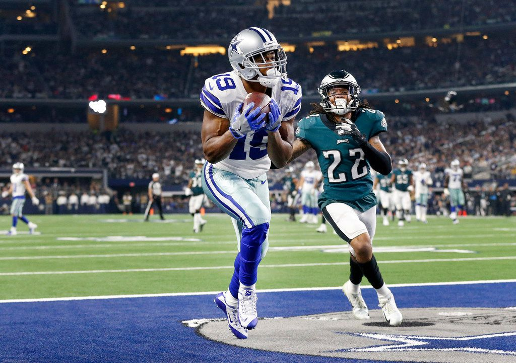 Dallas Cowboys wide receiver Amari Cooper (19) pulls in a long touchdown pass in the end zone after beating Philadelphia Eagles cornerback Sidney Jones (22) during the fourth quarter at AT&T Stadium in Arlington, Texas, Sunday, December 9, 2018. The Cowboys won, 29-23. (Tom Fox/The Dallas Morning News)