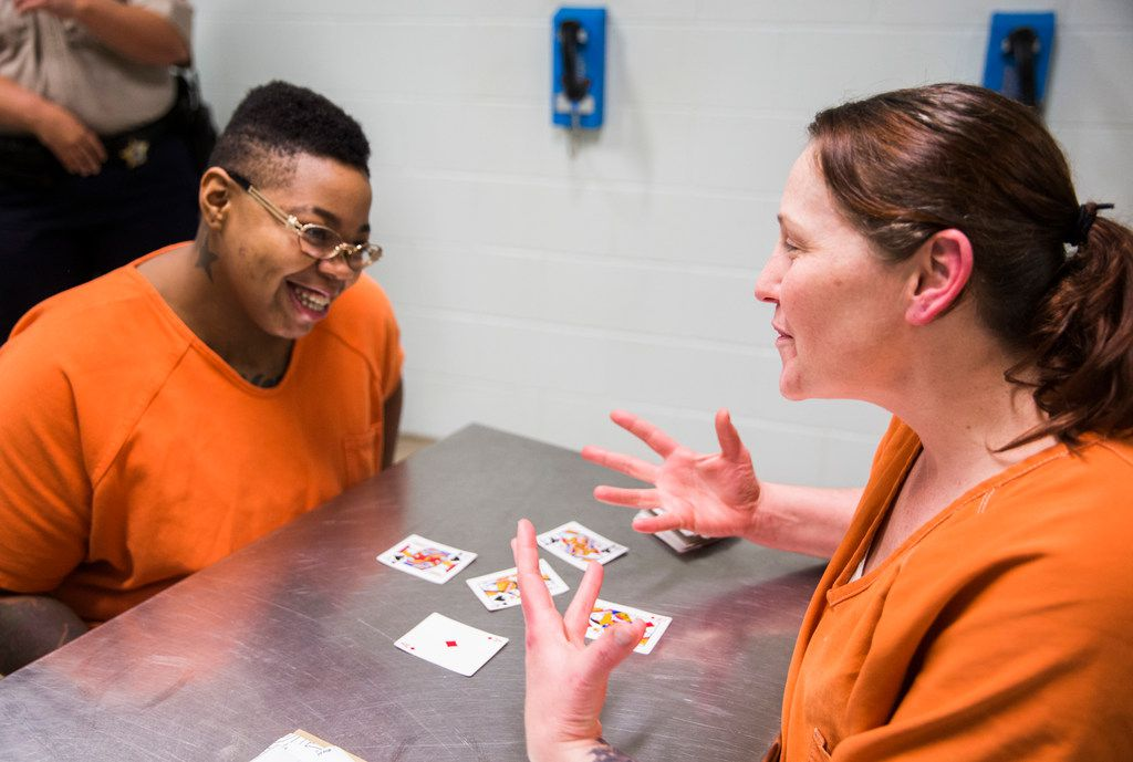 Inmates Sheniqua Miller, 23, (left) and Stacy Jensen, 38, play cards in their unit at the Burnet County Jail. Both women are facing drug charges; Miller has been jailed there since October and Jensen has been in nearly six months. Jensen's bond is set at $300,000.