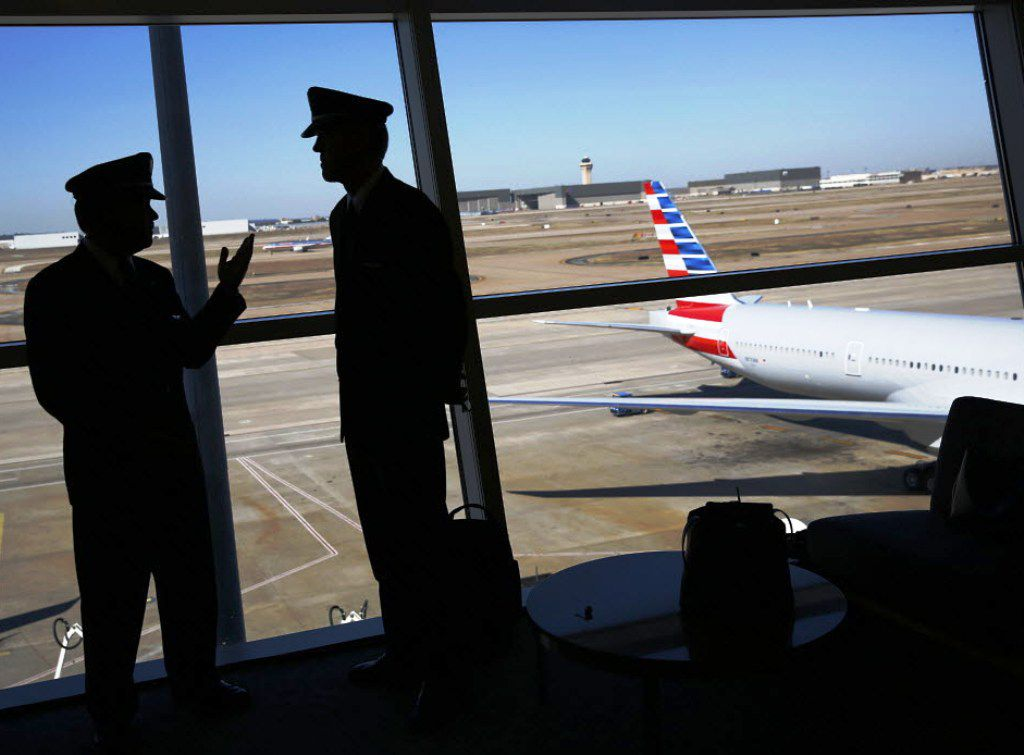 American Airlines pilots talked after the airline's merger with US Airways was announced in February 2013. (File Photo/Tom Fox)
