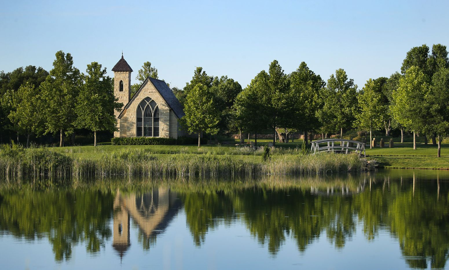 The chapel is reflected in one of the man-made lakes  on Mesa Vista Ranch.