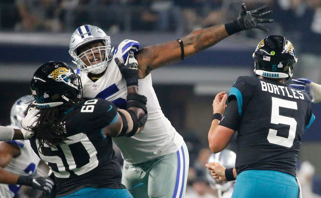 FILE - Cowboys defensive lineman David Irving (95) fights a block by Jaguars offensive guard A.J. Cann (60) during a game at AT&T Stadium in Arlington on Sunday, Oct. 14, 2018. (Louis DeLuca/The Dallas Morning News)