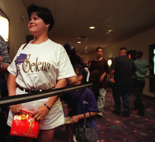 Elsa Salazar of Euless waits in line March 21, 1997, to  enter the 7 p.m. showing of Selena at the AMC Grand.