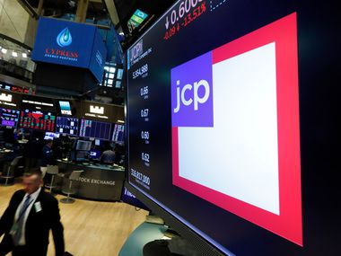 The JC Penney logo appears above a trading post on the floor of the New York Stock Exchange on Aug. 9
