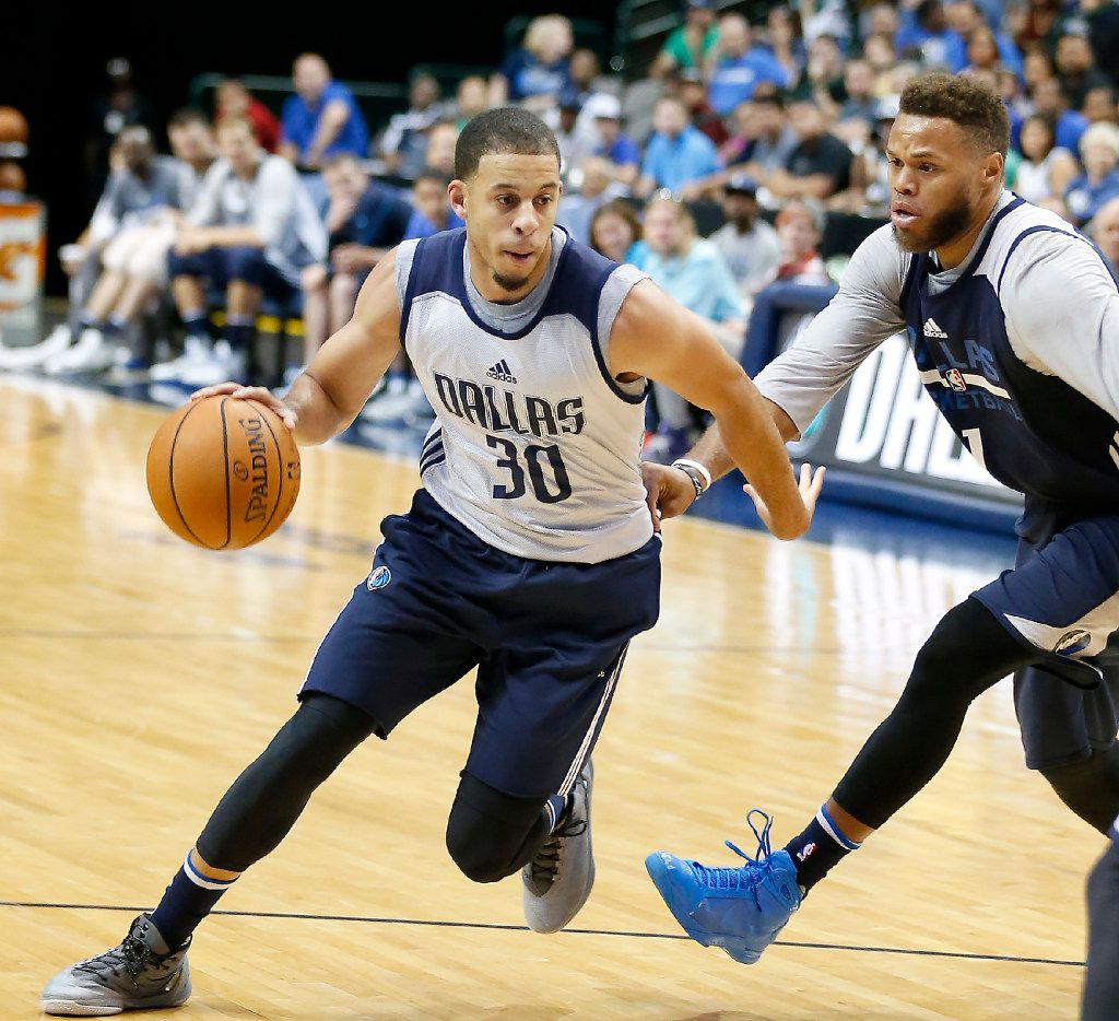 Mavericks guard Seth Curry drives against Justin Anderson during Wednesday's open scrimmage.  (Jae S. Lee/The Dallas Morning News)