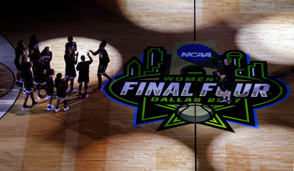 The Mississippi State Lady Bulldogs huddle up on the court after pregame introductions before facing the South Carolina Gamecocks in the NCAA Women's Final Four championship game at the American Airlines Center in Dallas, Sunday, April 2, 2017. (Tom Fox/The Dallas Morning News)