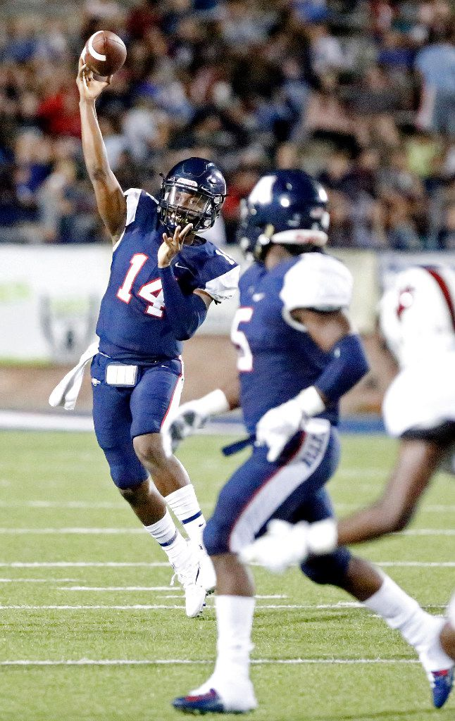 Allen quarterback Grant Tisdale (14) looks for running back Brock Sturges (5) during the first half as Allen High School hosted Cedar Hill High School in a football game at Eagle Stadium on Friday night, September 1, 2017. (Stewart F. House/Special Contributor)
