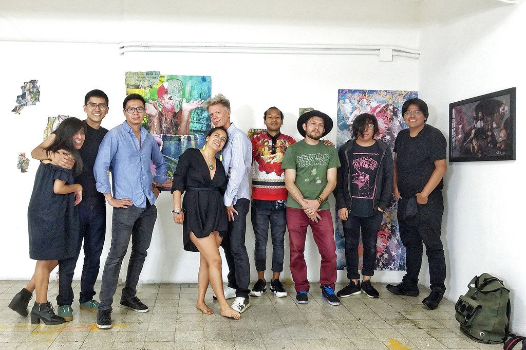 """In this 2018 photograph, artists Randall Garrett, who is participating in """"Pass the Peas"""" is shown with a group of artists he organized from Mexico City for an event at his Plush Gallery in Dallas. From left to right: Yaudiel Jim nez, Salve C sar, Pablo Tonatiuh Alvarez Reyes, Alba Vida, Randall Garrett, Alan M ndez, Rom n Olayo Estrada, Brian Martinez, and Adri n Coss."""