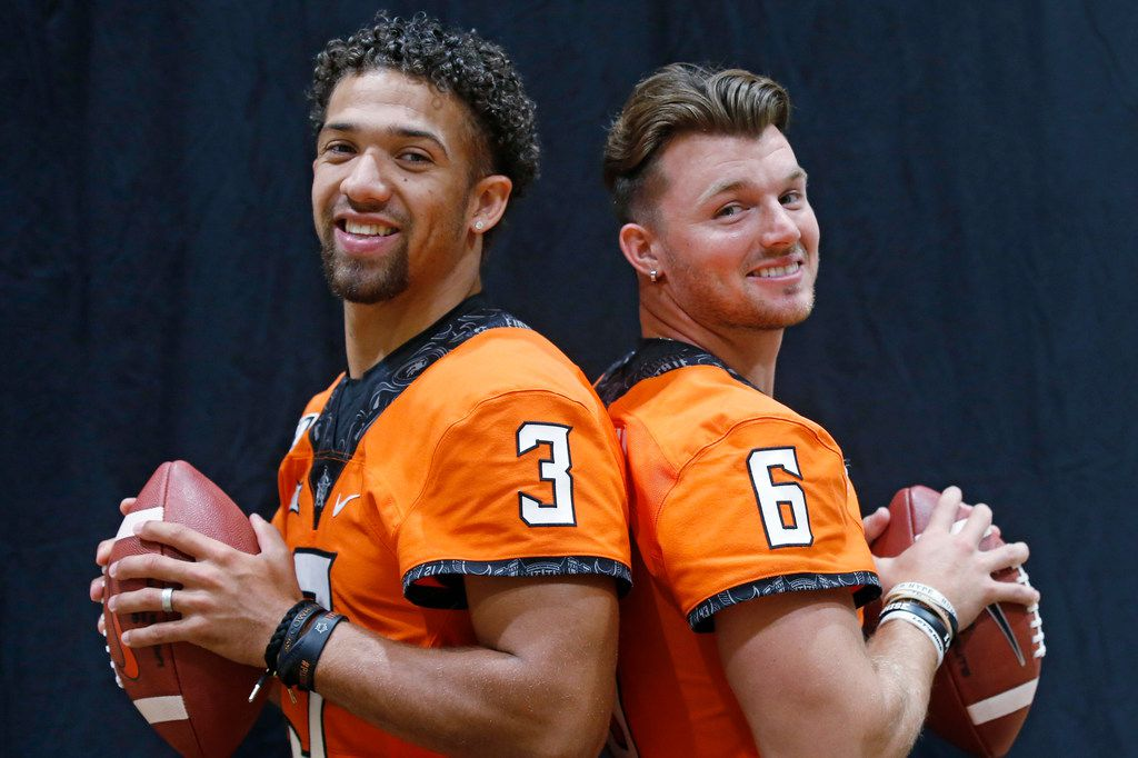 Oklahoma State quarterbacks Spencer Sanders, left, and Dru Brown, right, pose for a photo during an NCAA college football media day in Stillwater Okla., Saturday, Aug. 3, 2019. (AP Photo/Sue Ogrocki)