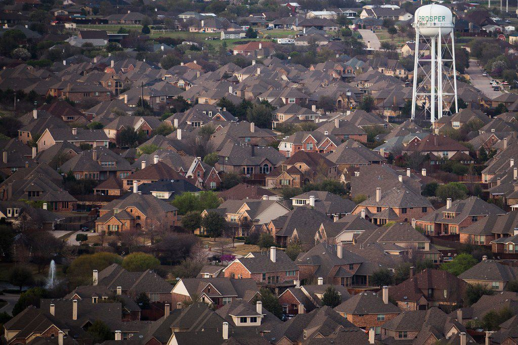 Rows of suburban homes seen in an aerial view in Prosper, Texas. (Smiley N. Pool/The Dallas Morning News)