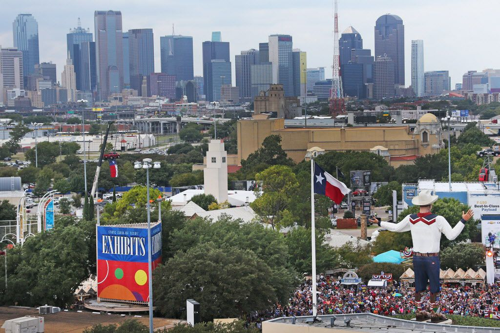 A crowd gathers for the opening ceremony next to the new Big Tex on the first day of the 2013 State Fair of Texas. (Louis DeLuca/Dallas Morning News)
