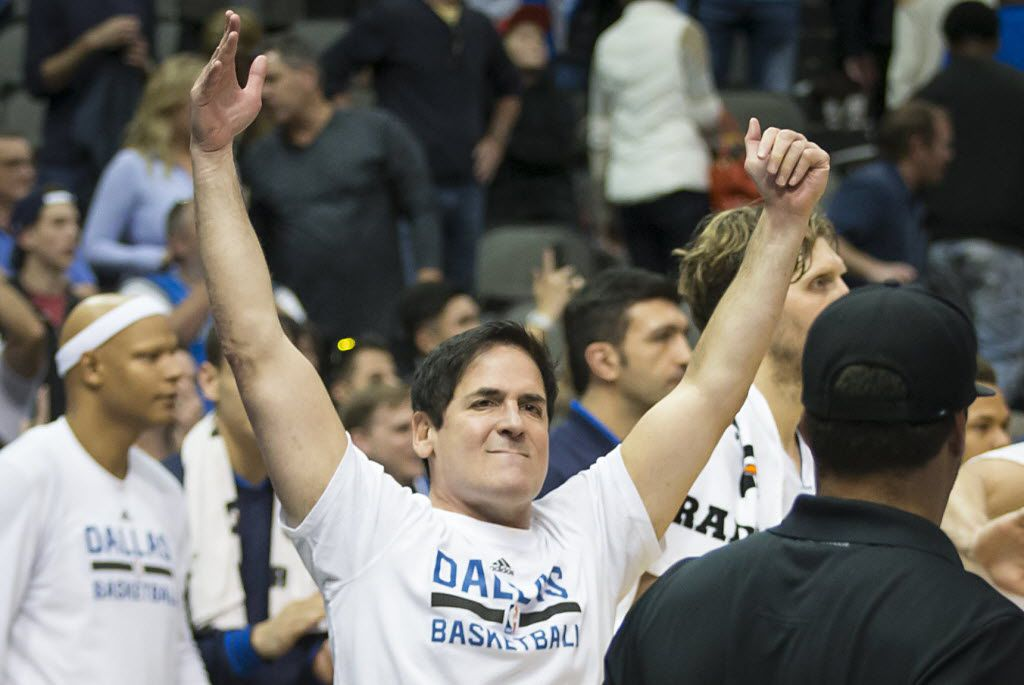 Dallas Mavericks owner Mark Cuban celebrates an overtime victory over the Portland Trail Blazers in an NBA basketball game at American Airlines Center on Sunday, March 20, 2016, in Dallas. . (Smiley N. Pool/The Dallas Morning News)