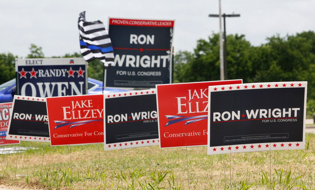 Competing signs for US Congressional candidates in District 6 stand outside the Ellis County Courthouse in Ennis, Texas on Monday May 14, 2018 for primary voting.