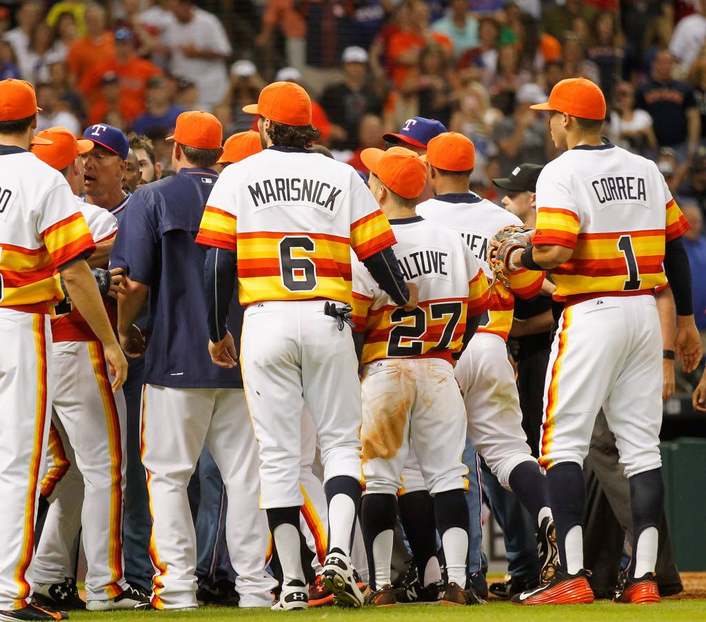 HOUSTON, TX - JULY 18:  Rangers manger Jeff Banister (blue hat at far left) during a bench clearing scuffle had both teams on the field in the ninth inning at Minute Maid Park on July 18, 2015 in Houston, Texas.  (Photo by Bob Levey/Getty Images)