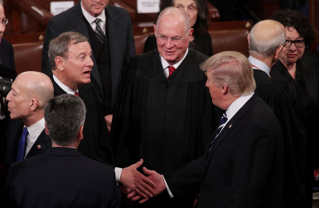 WASHINGTON, DC - FEBRUARY 28:  U.S. President Donald Trump shakes hands with Supreme Court Chief Justice John Roberts during a joint session of the U.S. Congress on February 28, 2017 in the House chamber of  the U.S. Capitol in Washington, DC. Trump's first address to Congress focused on national security, tax and regulatory reform, the economy, and healthcare.  (Photo by Alex Wong/Getty Images)
