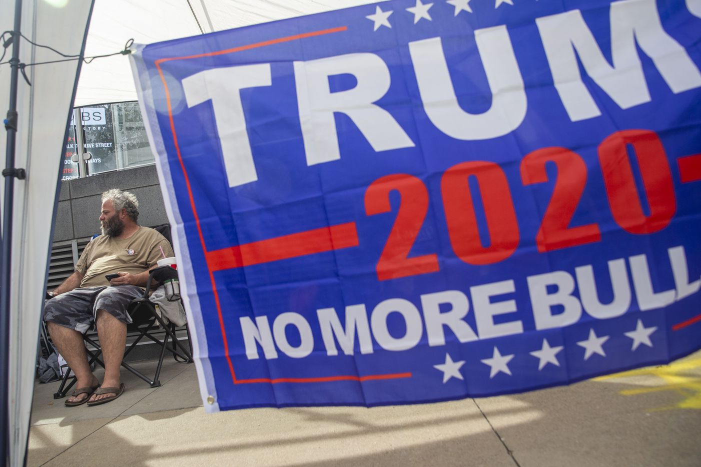 Glen Collins, from Waco, Texas, camps out in line in front of the American Airlines Center in Dallas on Wednesday, Oct. 16, 2019. President Donald Trump will host a rally at the center on Thursday evening.