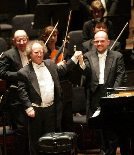 Jaap van Zweden (right) and pianist Jeffrey Kahane shook hands after the performance of Ravel's Concerto in G Major for Piano and Orchestra on Feb. 16, 2006, marking van Zweden's DSO debut.