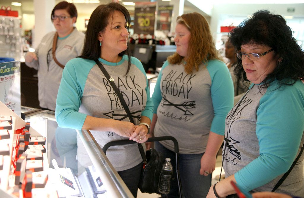 Tamara Powell (left) looked at jewelry with Victoria Barnes during Black Friday shopping at J.C. Penney in Fairview on Thanksgiving.