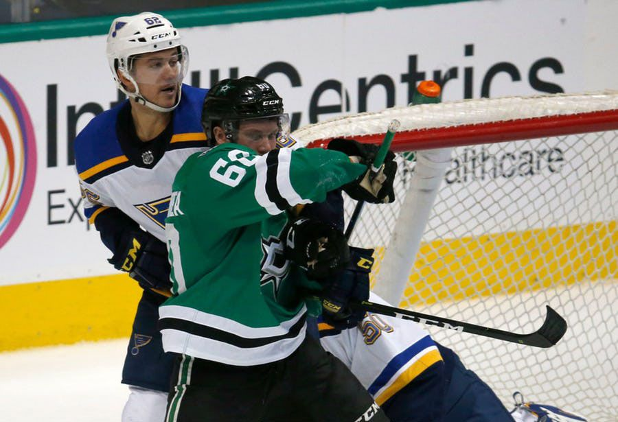 Dallas Stars center Ty Dellandrea (60) is held by St. Louis Blues left wing Mackenzie MacEachern (62) during the third period of their hockey game at American Airlines Center in Dallas on Sept. 18, 2018. Dallas Stars won the game 5-3. (Nathan Hunsinger/The Dallas Morning News)