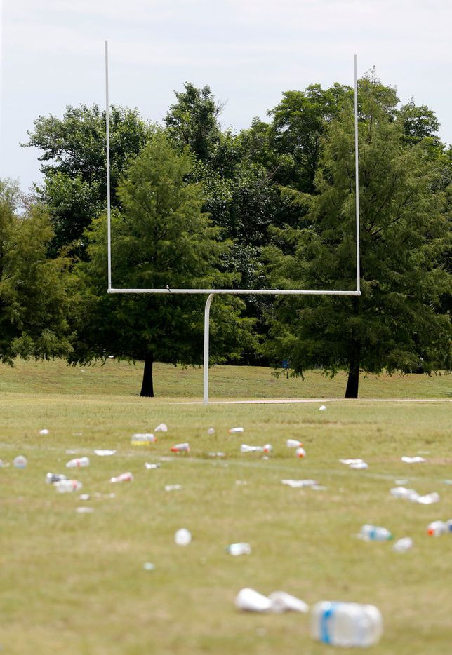 Debris on the football field at the Juanita Craft Recreation Center in Dallas. Five people were caught in the crossfire at the park following a neighborhood football game.