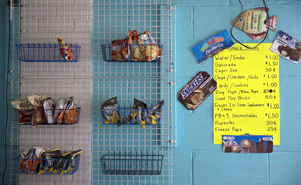 Chips, candies and other snacks were for sale at the Texas Pool on June 30, 2015, in Plano. The saltwater pool has been in operation for more than 50 years.