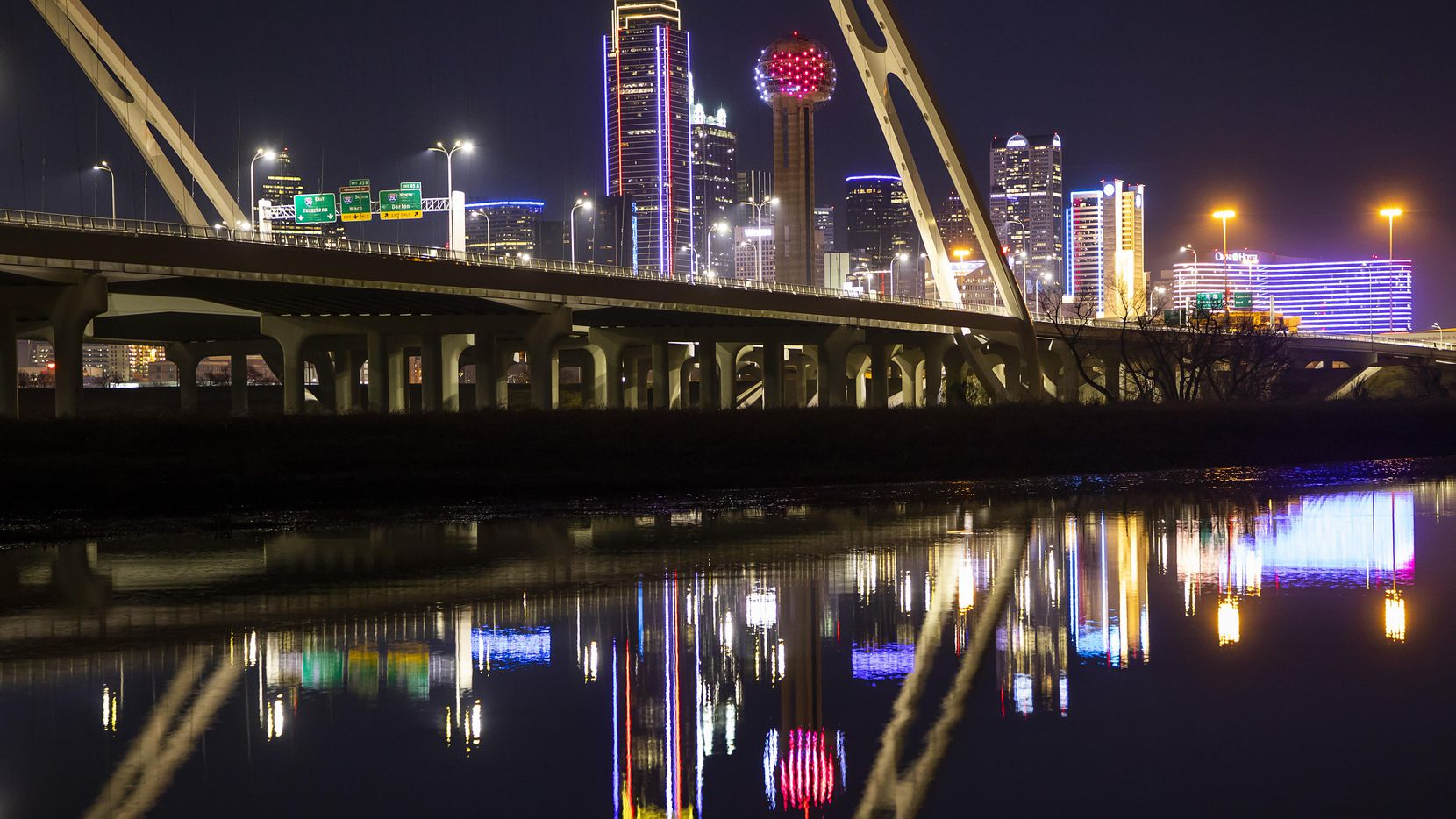 The downtown Dallas skyline is seen behind the Margaret McDermott Bridge.