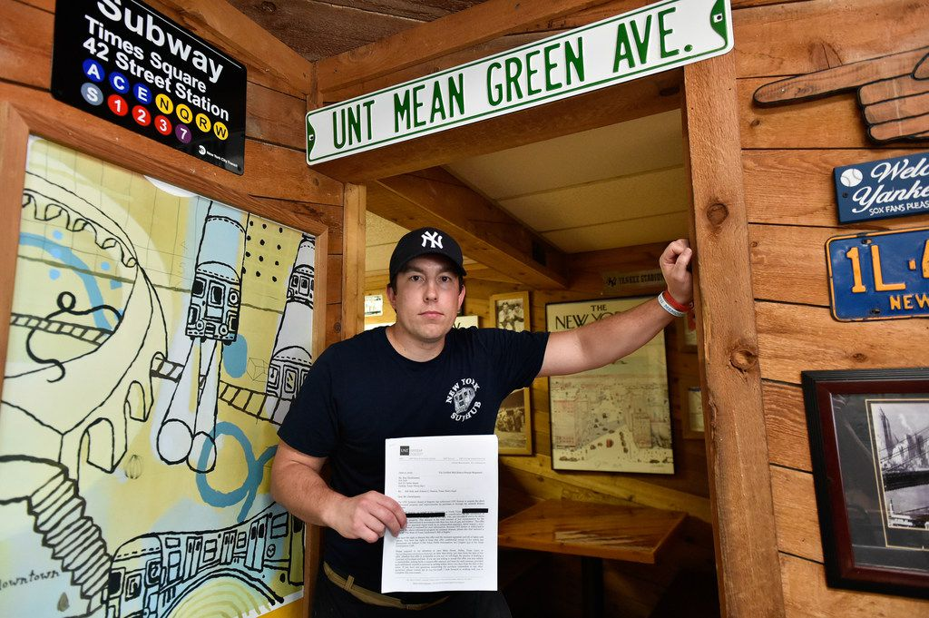 Hunter Christiansen, the owner of New York Sub Hub, holds an offer letter from the University of North Texas to buy the property. The UNT System Board of Regents voted in November to acquire the property.