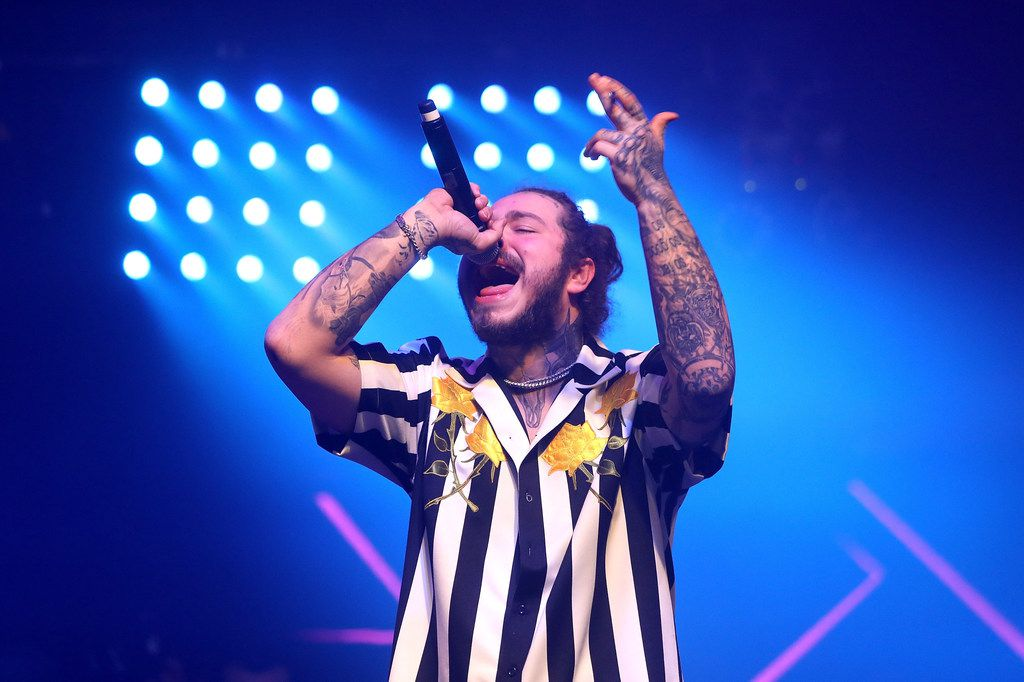 Post Malone performs onstage at the 2018 Billboard Music Awards. He snagged four Grammy nominations in December 2018.