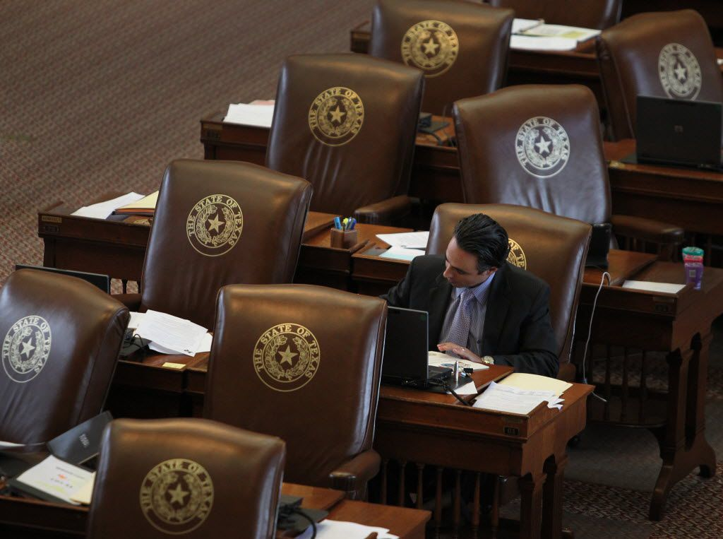 State Rep. Terry Canales, D-Edinburg, worked at his House desk in the Capitol in 2013. He passed a major bill this year that allows citizens to comment at the start and end of a public meeting — along with public comment during deliberations.