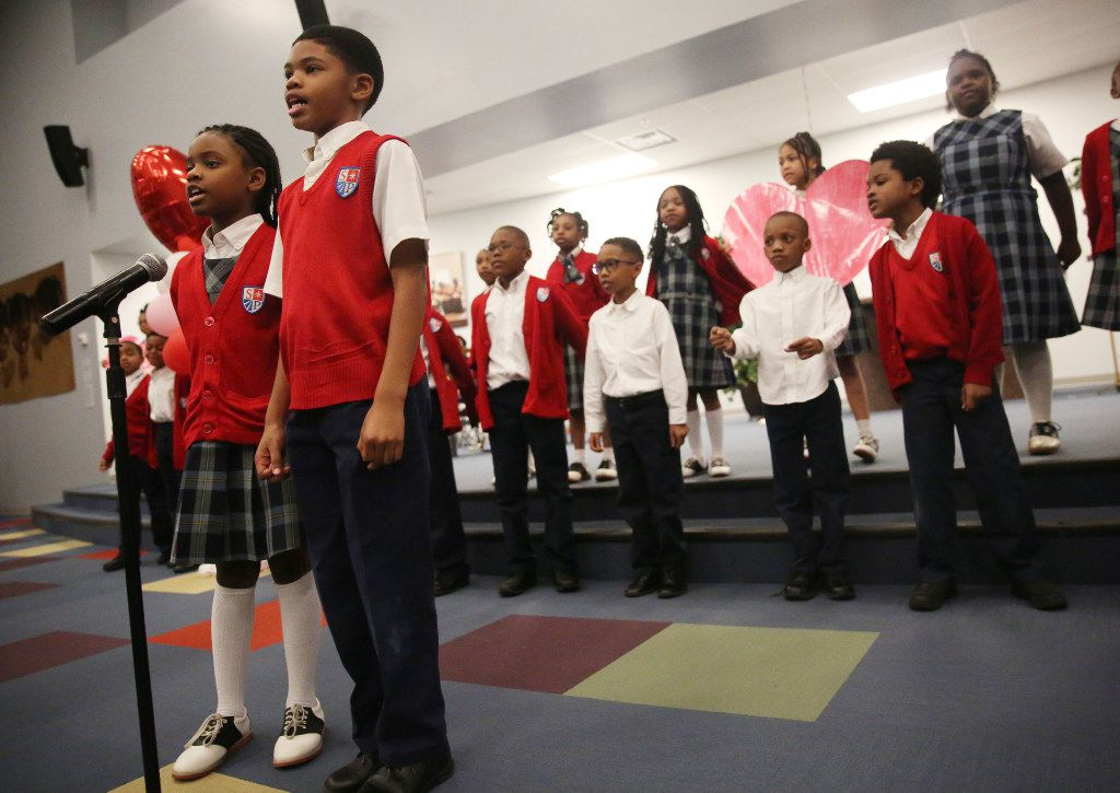 Second-grader Jillian Evans and third-grader Kelvin Walker sing during a Valentine's Day service at St Philip's School and Community Center in Dallas. (Rose Baca/The Dallas Morning News)