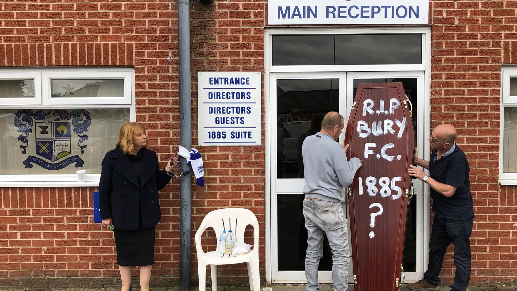 Former Bury FC director Joy Hart, who has handcuffed herself to the main stand at Gigg Lane, pleads for help to save the club as fans deliver a symbolic coffin to the front door.