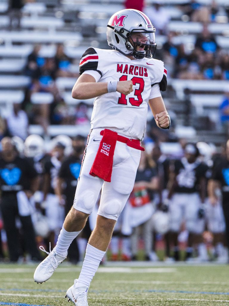 Flower Mound Marcus quarterback Garrett Nussmeier (13) celebrates after a touchdown during the first quarter of a high school football game between Flower Mound Marcus and Arlington Bowie on Thursday, August 29, 2019 at Wilemon Field in Arlington. (Ashley Landis/The Dallas Morning News)