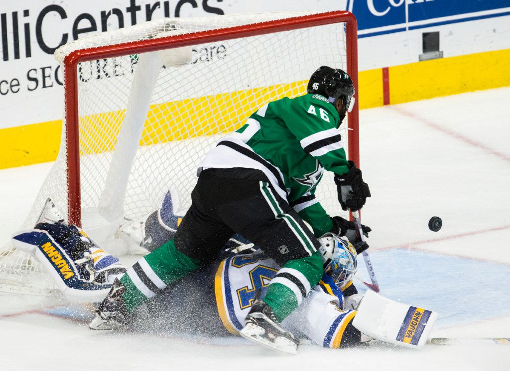 Dallas Stars center Gemel Smith (46) reaches for the puck over St. Louis Blues goalie Jake Allen (34) in a goal attempt during the third period of their game on Thursday, November 3, 2016 at the American Airlines Center in Dallas. (Ashley Landis/The Dallas Morning News)