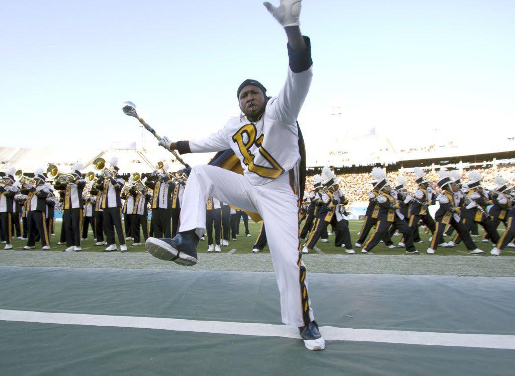Prairie View A&M drum major Joshua Williams high steps during the annual State Fair Classic at the Cotton Bowl in 2015.