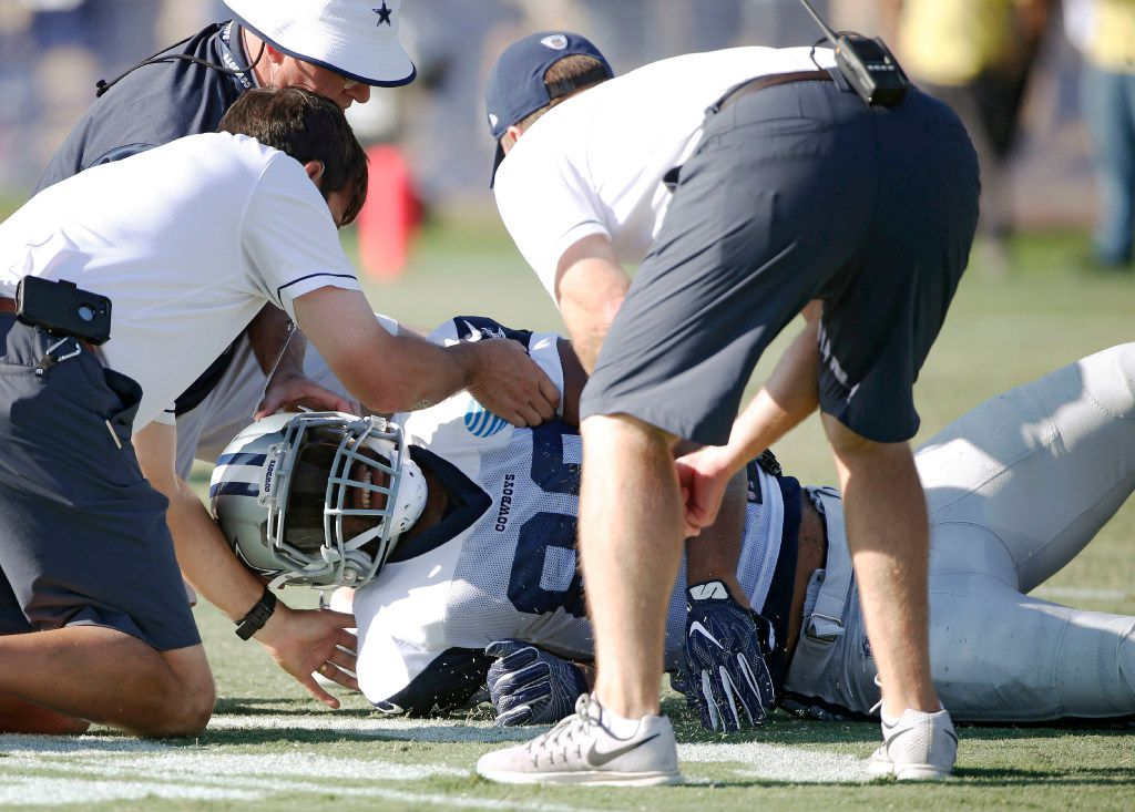 Dallas Cowboys tight end Rico Gathers (80) is tended to by Dallas Cowboys staff after a head to head collision with Dallas Cowboys strong safety Kavon Frazier (35) during the afternoon practice at training camp in Oxnard, California on Tuesday, August 15, 2017. (Vernon Bryant/The Dallas Morning News)