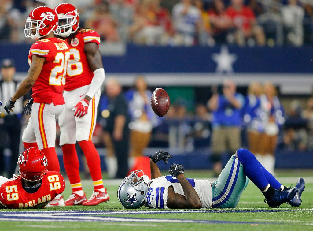 Dallas Cowboys wide receiver Dez Bryant (88) tosses the football as he lies on the field after sustaining an injury in the third quarter against the Kansas City Chiefs at AT&T Stadium in Arlington, Texas, Sunday, November 5, 2017. (Tom Fox/The Dallas Morning News)