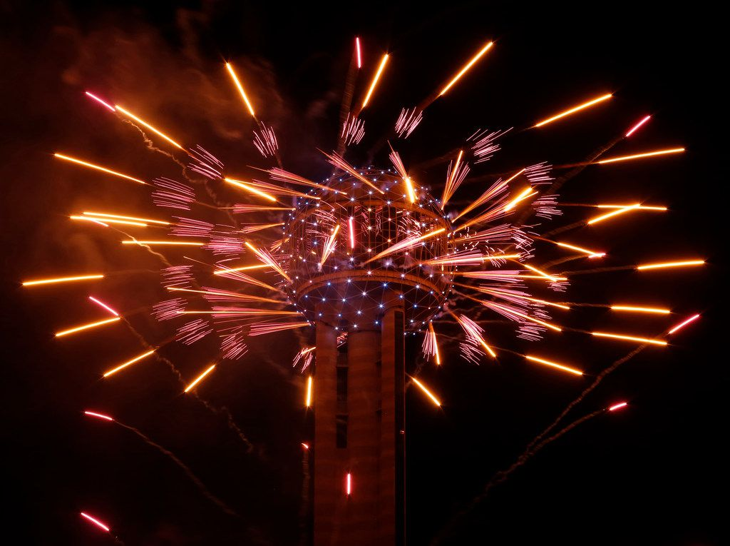 Fireworks fly from Reunion Tower during the New Year's Eve event in Dallas on December 31, 2016.  (Nathan Hunsinger/The Dallas Morning News) ORG XMIT: DMN1701010020415147