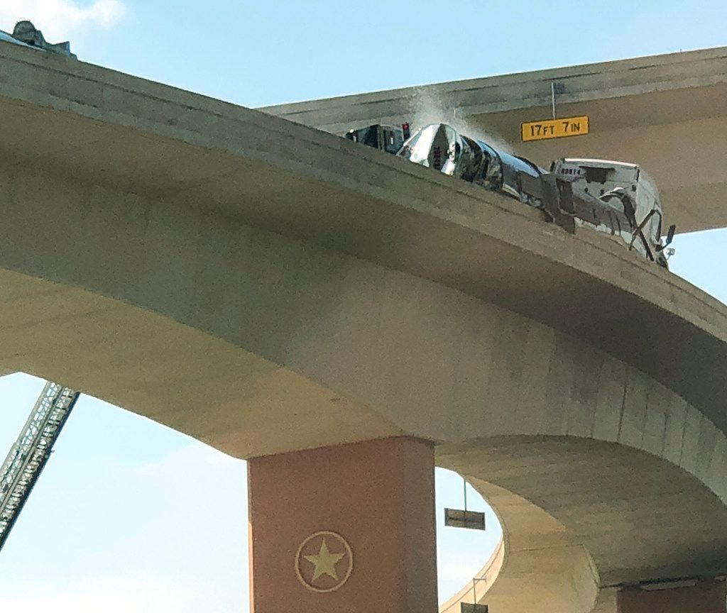 """A tanker ferrying a """"highly flammable"""" resin rolled on its side about 4:15 a.m. on the ramp from southbound Highway 75 to eastbound LBJ Freeway in Dallas on Thursday morning."""