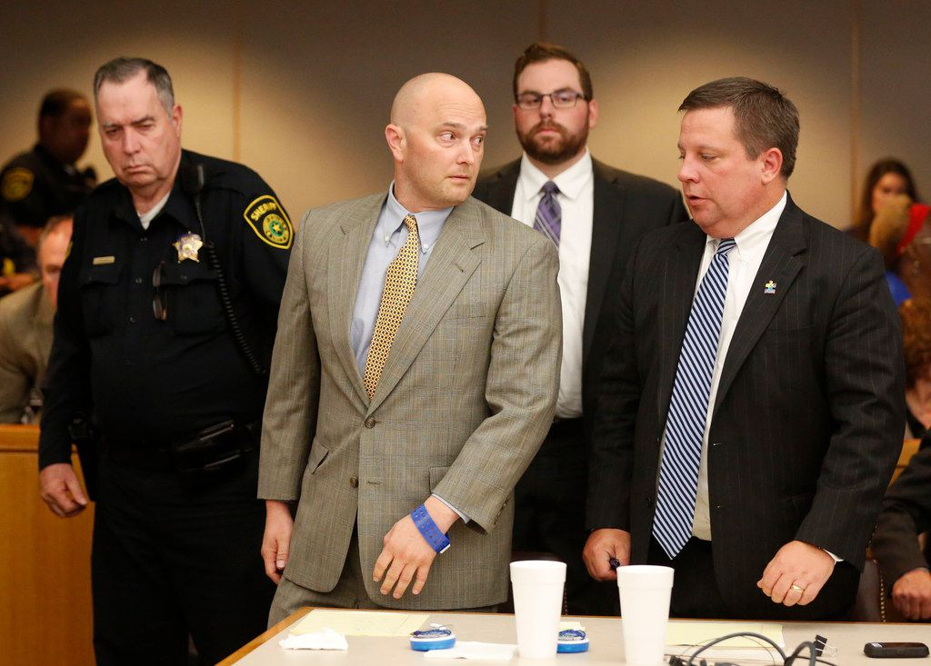 Roy Oliver, fired Balch Springs police officer, looks to his defense attorney Miles Brissette before being taken away by the bailiff after receiving a sentence of 15 years in prison for the murder of 15-year-old Jordan Edwards after over five hours of punishment deliberation at the Frank Crowley Courts Building in Dallas on Wednesday, Aug. 29, 2018. (Rose Baca/The Dallas Morning News)
