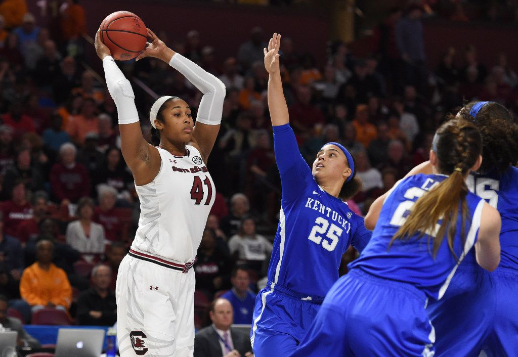 South Carolina center Alaina Coates (41) looks to pass as Kentucky guard Makayla Epps (25) defends in the first half of an NCAA college basketball game during the Southeastern Conference tournament on Saturday, March 4, 2017, in Greenville, S.C. (AP Photo/Rainier Ehrhardt)