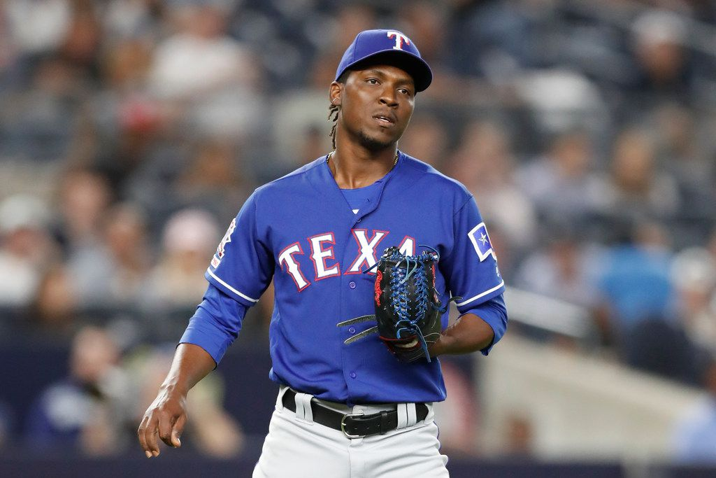 Texas Rangers' relief pitcher Rafael Montero reacts on the mound after allowing a two-run, home run to New York Yankees designated hitter Edwin Encarnacion during the seventh inning of a baseball game, Tuesday, Sept. 3, 2019, in New York. (AP Photo/Kathy Willens)