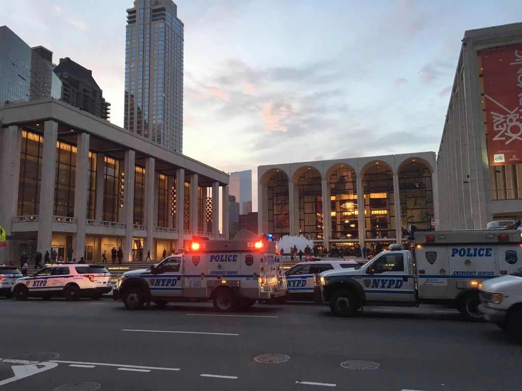 Police responded to New York's Metropolitan Opera, which halted a performance after someone sprinkled an unknown powder into the orchestra pit on Saturday. Met spokesman Sam Neuman said the afternoon's performance of Guillaume Tell was canceled during the second intermission after the person sprinkled the powder into the pit from the orchestra section. (Dylan Hayden/The Associated Press)