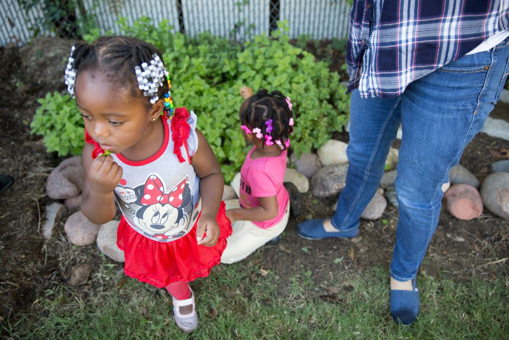 Serayah Ward (left), 2, plays in the therapy garden at Vogel Alcove.